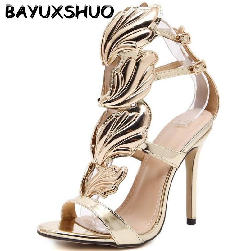 BAYUXSHU Summer Women High Heels Gold Winged Leaves Cut-outs Stiletto Gladiator Sandals Flame Party High heel Sandal Shoes Woman close-up