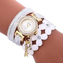 eee7b86e13b5 Pulsera de mujer Relojes de Cuero PU Flor de imitación llave colgante reloj  damas libélula estilo étnico chica urbana moda Dama .