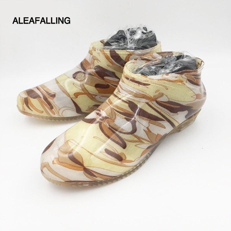 купить Aleafalling new arrival rain boots waterproof shoes woman rain woman water rubber ankle boots slip on flower botas 37-41 m102 по цене 560.3 рублей