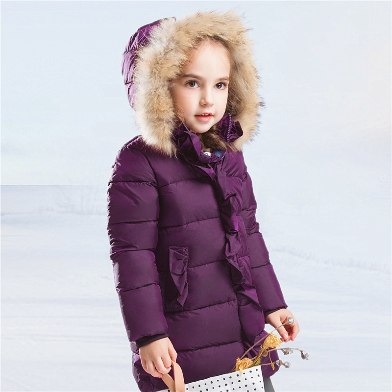 Фото Down Jacket Girl The Girl In The Long Thick Coat Baby Warm Winter Children New Large Fur Collar New Year A Lively Girl Dressed