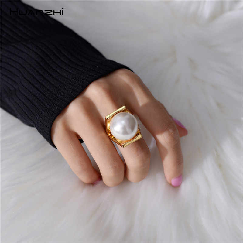 HUANZHI Imitation Pearls Personality Gold Color Metal Hollow Exaggeration Design Finger Rings for Women Girls Party Jewelry Gift