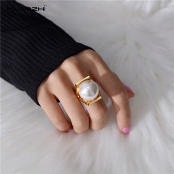 HUANZHI imitacje pereł osobowość złoty kolor Metal Hollow przesada projekt pierścienie dla kobiet dziewczyn Party biżuteria prezent tanie i dobre opinie CN (pochodzenie) Miedzi Kobiety Na co dzień sportowy Koktajl pierścień GEOMETRIC 16mm Wszystko kompatybilny Nastrój tracker