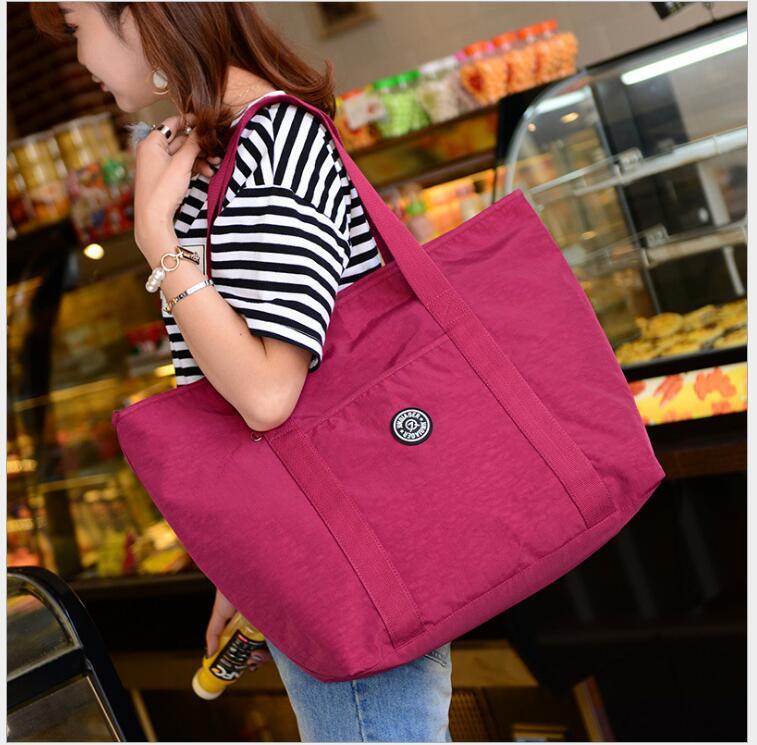 JINQIAOER Female Shoulder Bags light utility Women Bags 2018 Waterproof Nylon  Travel Beach Bags Casual Ladies Tote Bag b413563e75