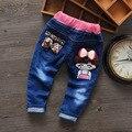 Primavera Denim Vaqueros Chicas Nuevos Niños Pantalón Largo Pokect Pantalones Niños Pantalones de los Bebés de Dibujos Animados Ocasional Niña Vaqueros de Golpeteo