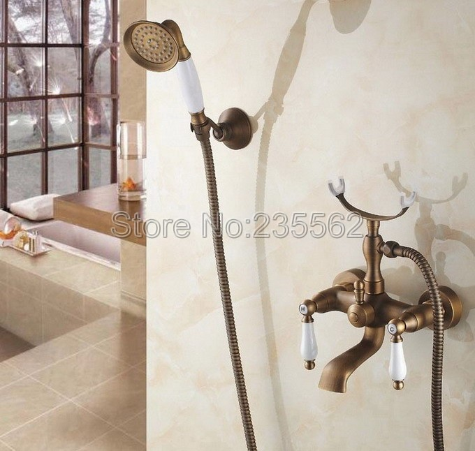 Antique Brass Wall Mounted Dual Handle Bathroom Faucet with Handheld Shower Clawfoot Tub Mixer Tap ltf156Antique Brass Wall Mounted Dual Handle Bathroom Faucet with Handheld Shower Clawfoot Tub Mixer Tap ltf156