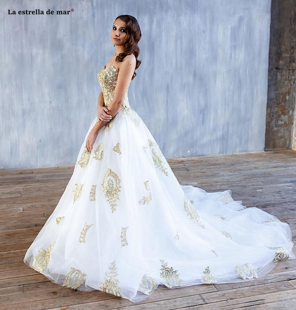 Abiti da sposa new tulle applique sexy sweetheart A Line white gold beach wedding gown long bestidos de novia cheap suknie slubn in Wedding Dresses from Weddings Events