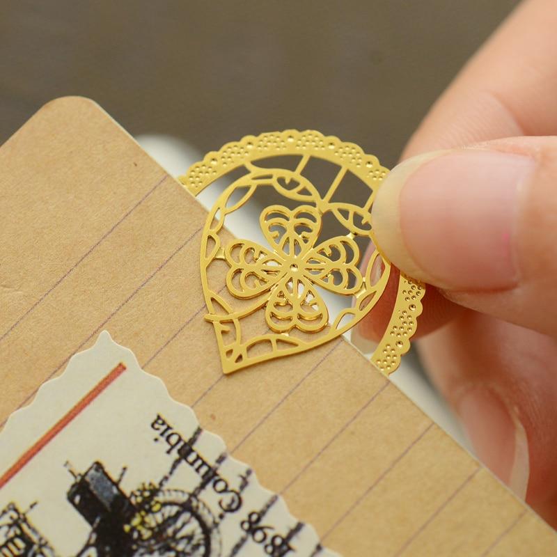 Купить с кэшбэком 70 pcs/Lot Gold Metal bookmarks Vintage key heart cat bookmark  for books page holder marcador de pagina School supply FC833