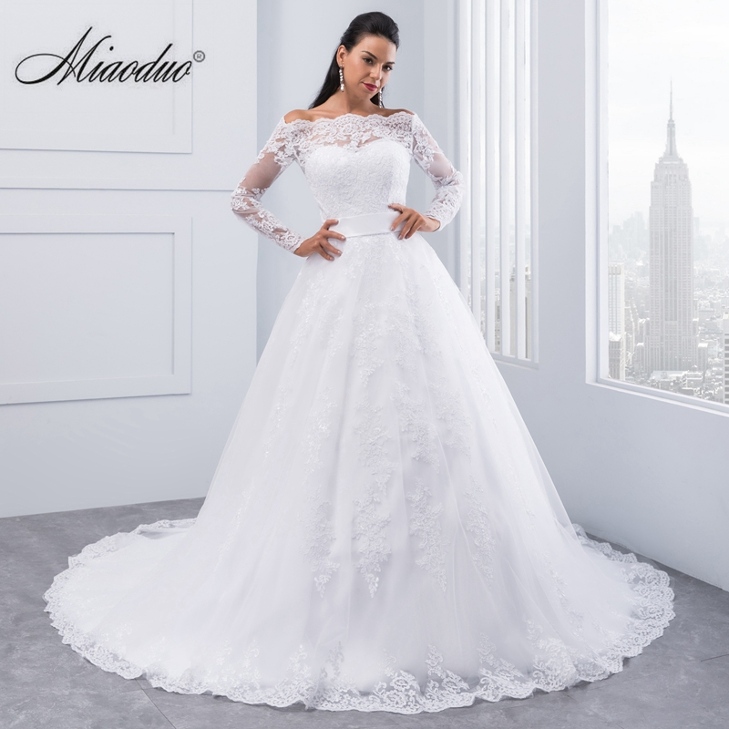 ee3e190e375ee 2019 Simple blanco boda vestidos princesa largo apliques Puffy vestido De  baile vestido de novia bata