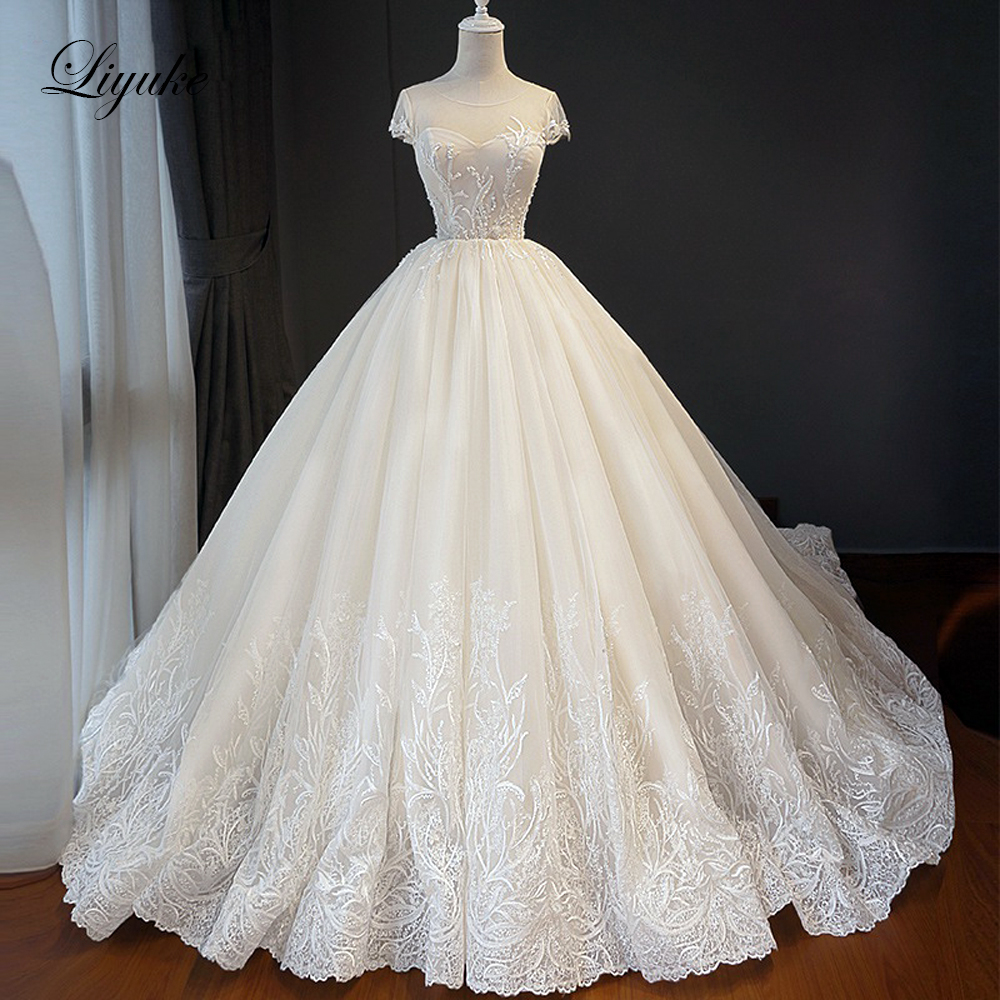 Liyuke Short Sleeve A Line Wedding Dress  With Chapel Train Elegant Applique Lace Up Wedding Gown