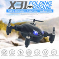 SYX31 Plegable 2.4 Ghz 4CH 6 Axis Gyro Control Remoto RC Quadcopter Drone