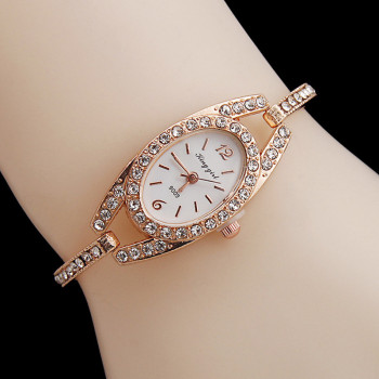 цена Luxury Brand Rhinestone Rose Gold Watches Women Stainless Steel Bracelet Diamante Quartz Watch Women Dress Watches female hours онлайн в 2017 году