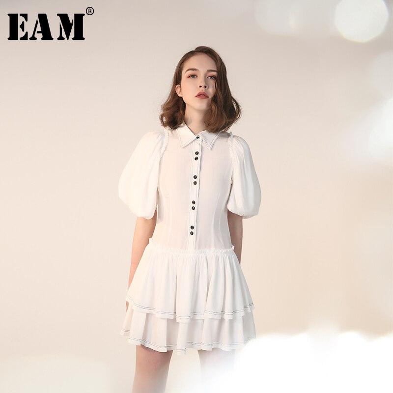 [EAM] 2019 nouveau printemps été revers manches bouffantes blanc bouton point ourlet plaqué lâche gâteau robe femmes mode marée JQ883
