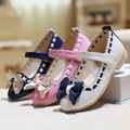 Factory direct laser drilling of new girls shoes bow in the fall children tongtong shoes wholesale girls leather shoes