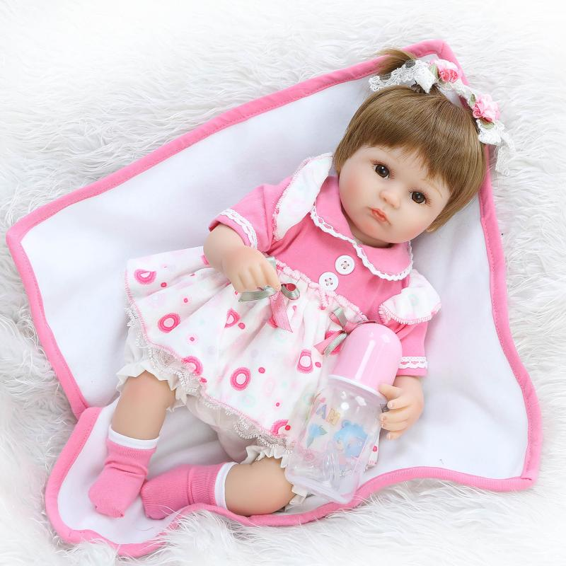 Nicery 18inch 45cm Reborn Baby Doll Magnetic Mouth Soft Silicone Lifelike Girl Toy Gift for Children Christmas Pink White Dress [mmmaww] christmas costume clothes for 18 45cm american girl doll santa sets with hat for alexander doll baby girl gift toy