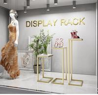 Golden clothing store rundown table decoration window bag display rack in the island display table cabinet high and low table.