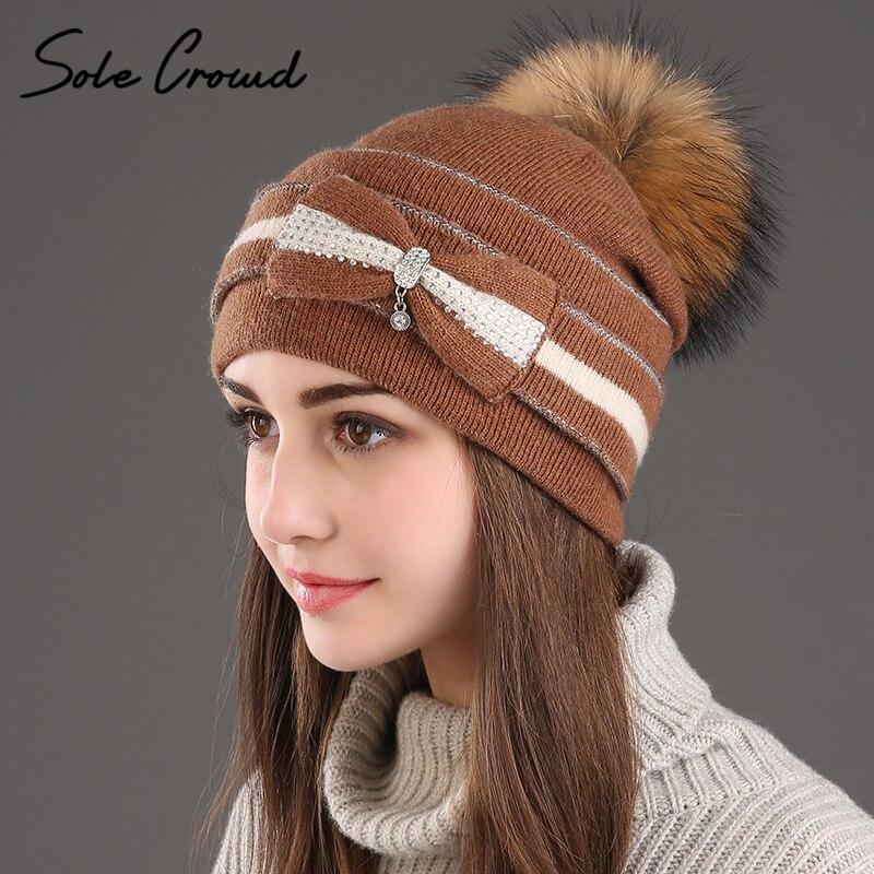 [Único] multitud invierno cálido arco lana sombreros de punto las mujeres moda pompom sombreros de mapache real gorras Beanie sombrero