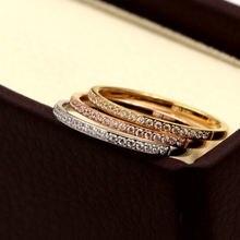 Женское кольцо из нержавеющей стали с фианитами золотистое/розовое