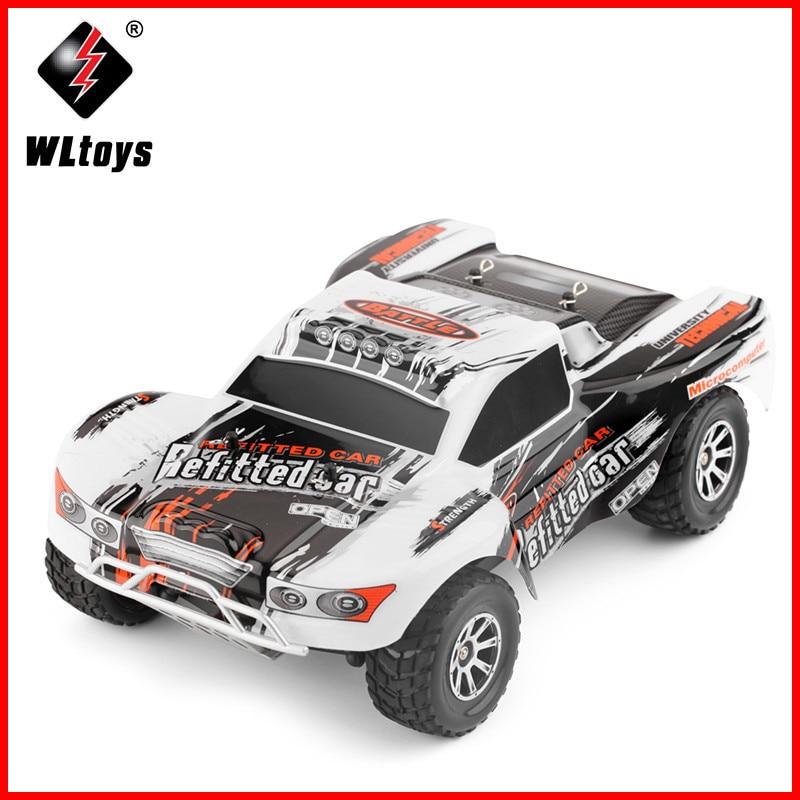 Original Wltoys A969 RC Carro 1/18 Brinquedos Escala 2.4G 4WD 70 km/h RC Deriva Curso de Curta Duração de Choque de quatro rodas de Controle de Longa Distância Absorbe