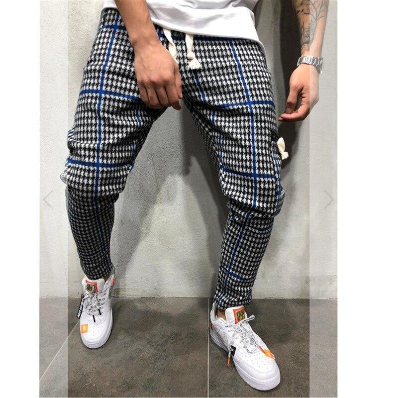 2019 New Fashion Brand Men's Pants Fashion Monochrome Stripe Stretch Men's Pants Casual Pants 3D Jogging Street Dancing PANTS