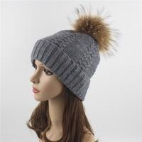 L'europa e gli stati Uniti vendite procione palla di pelo di lana lavorato a maglia del cappello donna inverno all'aperto tappo orecchio caldo