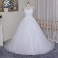 Beautiful Ball Gowns Sleeveless Tulle Wedding Dresses Illusion Neckline Appliques Elegant Bridal Gowns Custom Made Court