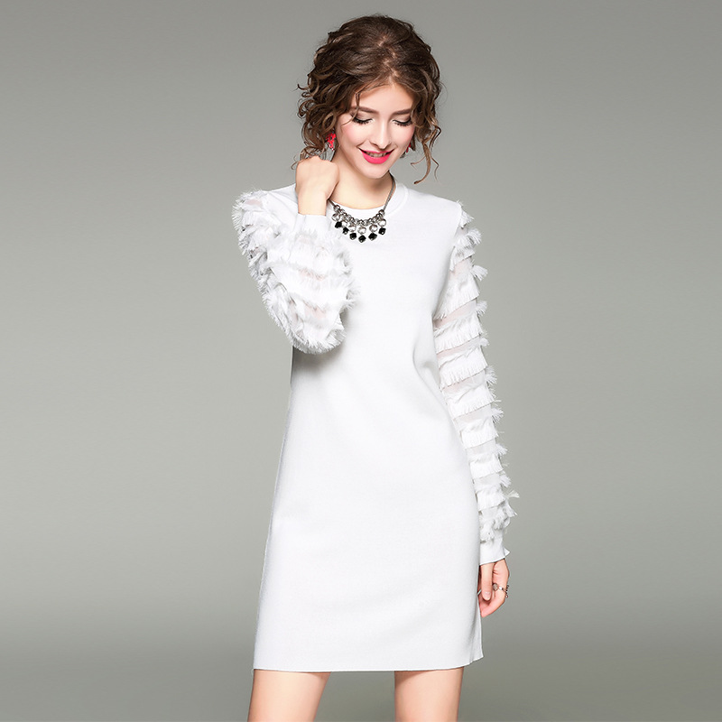 Long sleeve white feather dress.