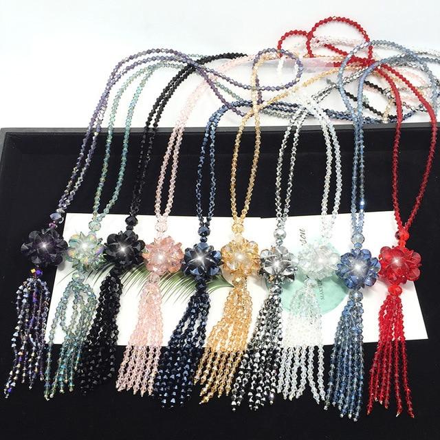 Фото длинное ожерелье с кристаллами женский модный свитер трендовая цена