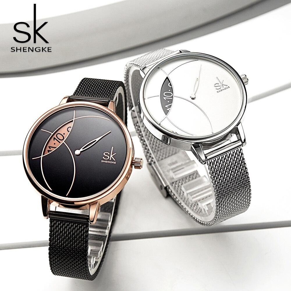 Shengke femmes mode montre créative dame décontracté montres en acier inoxydable maille bande design élégant argent Quartz montre pour femme