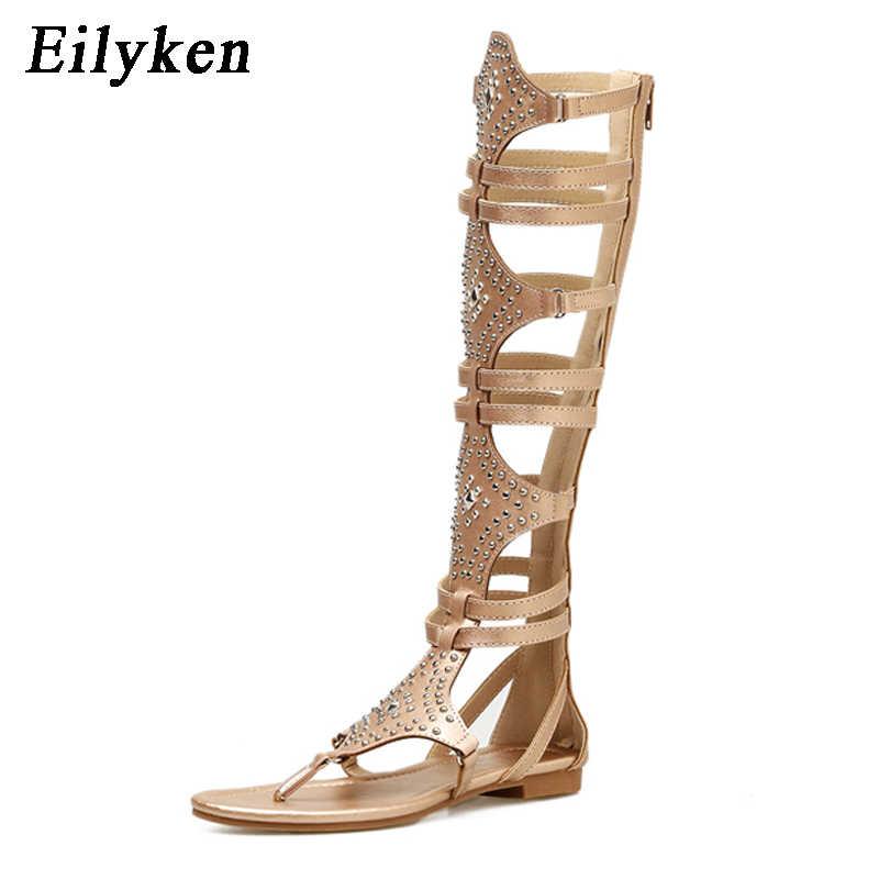 Eilyken 2020 Nuevo Dorado Negro Casual mujeres gladiador sandalias de Punta abierta de cuero hasta la rodilla remache DE LA sandalias de ocio botas planas