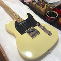 Selling Chinese electric guitar, yellow, cream electric guitar, maple neck, Korean paint