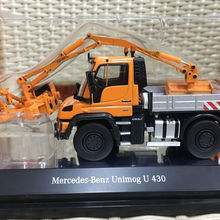 Mercedes-Benz Unimog U 430 с комбинированной косилкой оранжевый 1/50 от NZG 9101