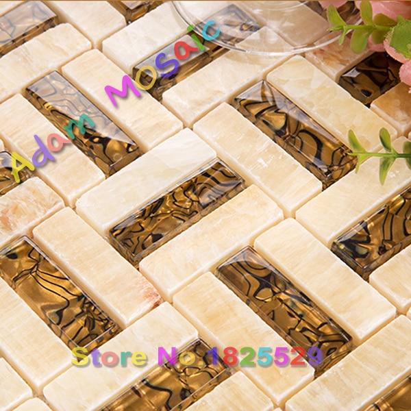 beige tile natural stone kitchen backsplash gloden amber glass