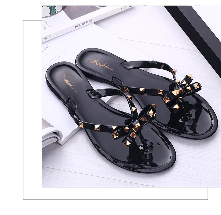 HTB1NSgiVXzqK1RjSZFoq6zfcXXaY 2019 new slippers female summer fashion rivet bow flip flops wear wild flat jelly shoes sandals and slippers