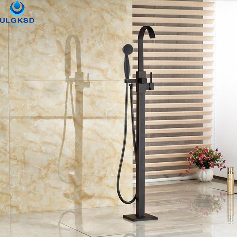 Ulgksd Wholesale and Retail Oil Rubbed Bronze Bathtub Tub Faucet Tub Filler Bathroom Faucet W/Hand Shower Mixer Tap Floor Mount oil rubbed bronze waterfall tub mixer faucet free standing floor mount bathtub faucet with handshower