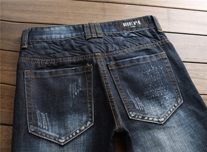 New arrival stylish mens dark blue biker ripped jeans patchwork zipper pantalones hip hop slim fit distressed denim pants men
