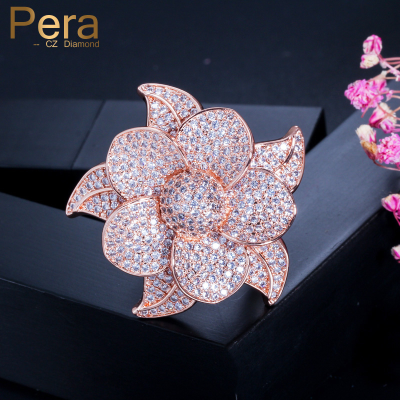 polymer flower silver plated Adjustable ring light pink ciuleur on green background flower fimo 4 centimeters diameter flat round