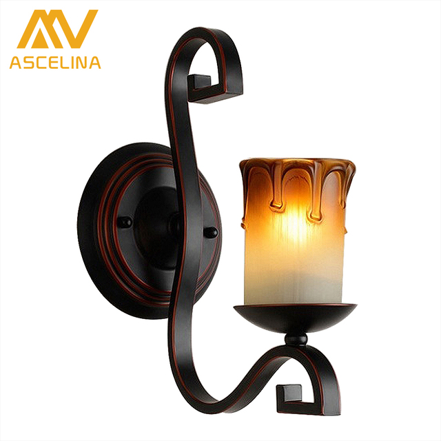 Modern iron candle light wall sconce rustic glass wall lamp led modern iron candle light wall sconce rustic glass wall lamp led bedroom hotel corridor wall lights creative candle lights in wall lamps from lights mozeypictures Images