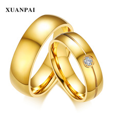 ФОТО XUANPAI Trendy Gold Color Stainless Steel Engagement Ring Prong Setting CZ Stone Wedding Bands Ring for Women Men iance