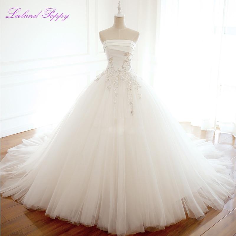 Women's A-line Strapless Tulle Wedding Dresses 2019 Sleeveless Crystal Beaded Empire Waistline Floor Length Bridal Gowns