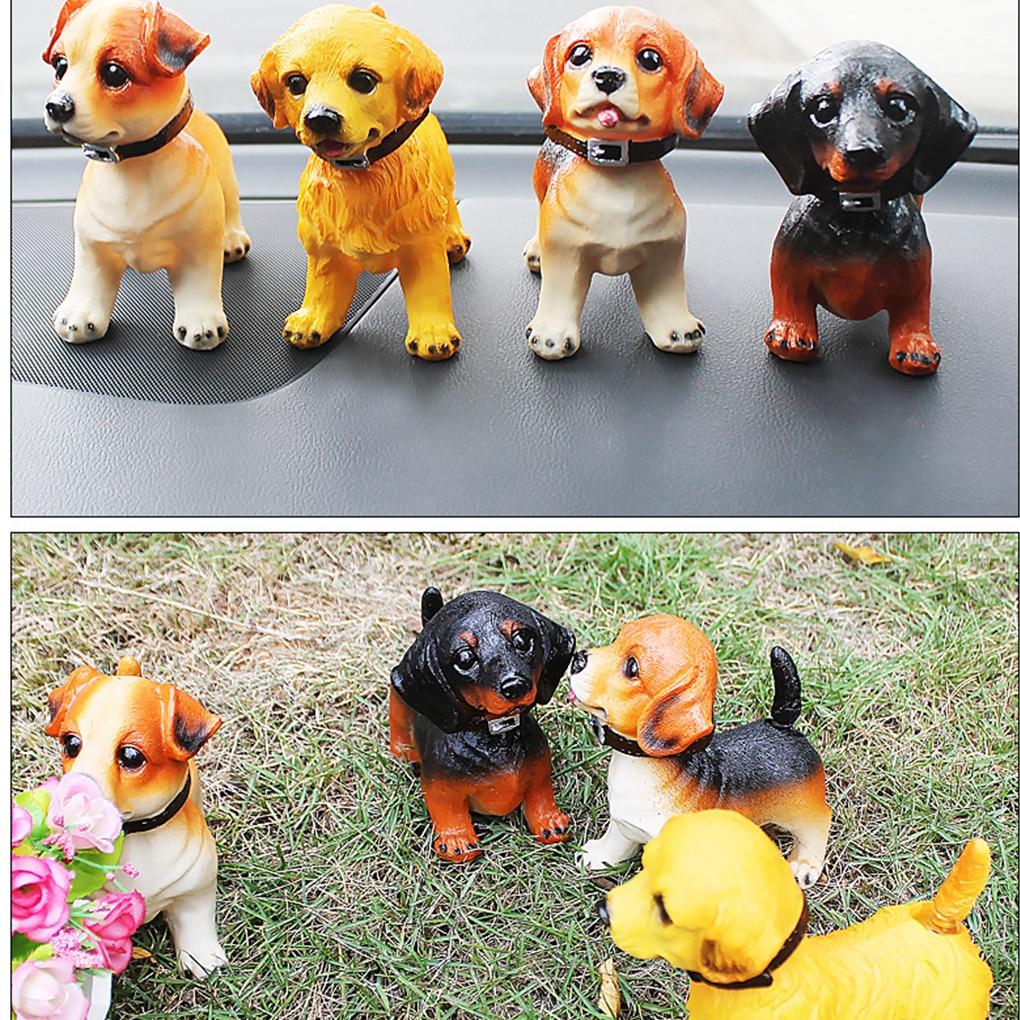 Милые украшения встряхивания собака украшения кивая смолы щенок пожимая качает головой собаки автомобиль собака украшения