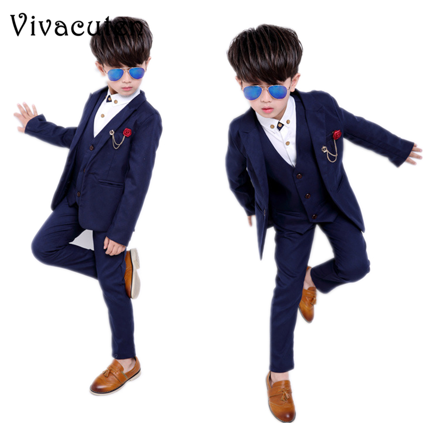 купить New Design 4Pcs Boys Solid Wedding Suit Gentle Kids Blazer Vest Shirt Pants Set Suit Boys Spring Formal Brooch Blazer Suit F006 по цене 2236.44 рублей