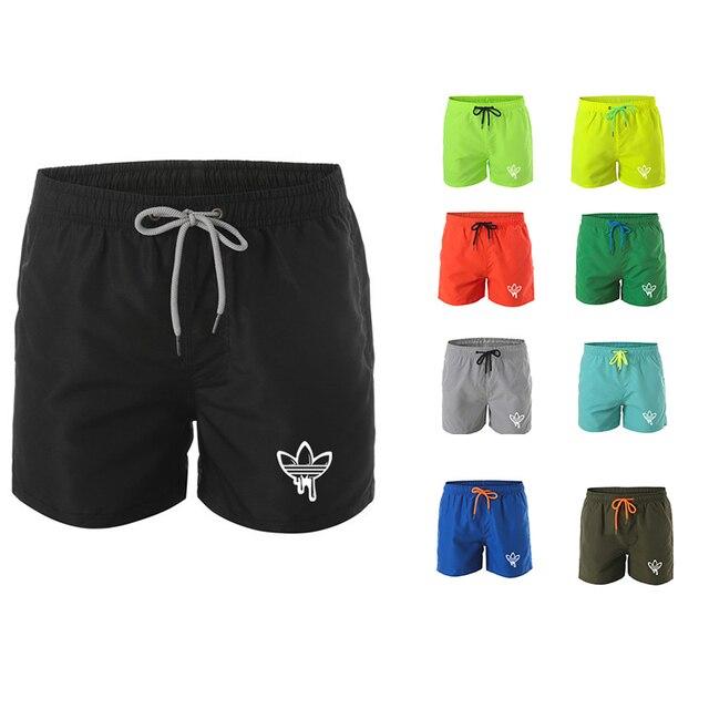 Mens מכנסיים קצרים חדרי כושר כושר פיתוח גוף מזדמן רצים אימון מותג ספורט קצר מכנסיים טרנינג ספורט