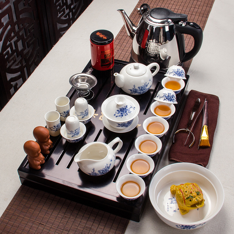 Yixing Kung Fu tea set solid wood tea tray teapot high quality ceramic tea sets cup with a electric kettle Yixing Kung Fu tea set solid wood tea tray teapot high quality ceramic tea sets cup with a electric kettle