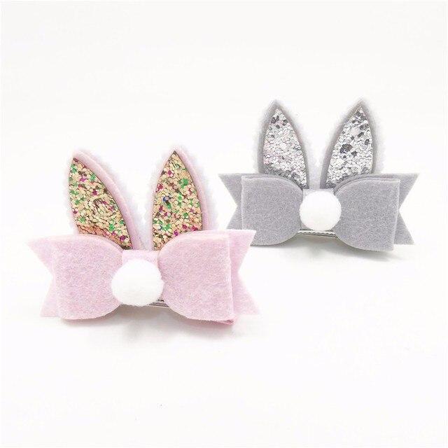 1 unid brillo del pelo del oído del conejito Clip con el arco del fieltro y blanco Pom rosa y gris del Partido de Pascua Barrette lindo Feltie niñas pinzas