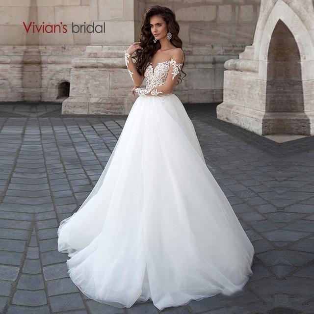 vestido de novia de manga larga con apliques de encaje sin espalda