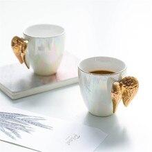 クリエイティブホワイトセラミックマグ金メッキハンドル天使の羽オフィスホームコーヒーミルク磁器マグカップルのギフト家の装飾