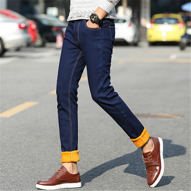 The winter warm trousers and jeans male cashmere thickened Korean slim feet type straight pants young men