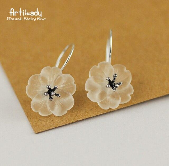 Artilady 925 sterling silver stud earrings fashion piezoelectricity white crystal flower earrings for women jewelry