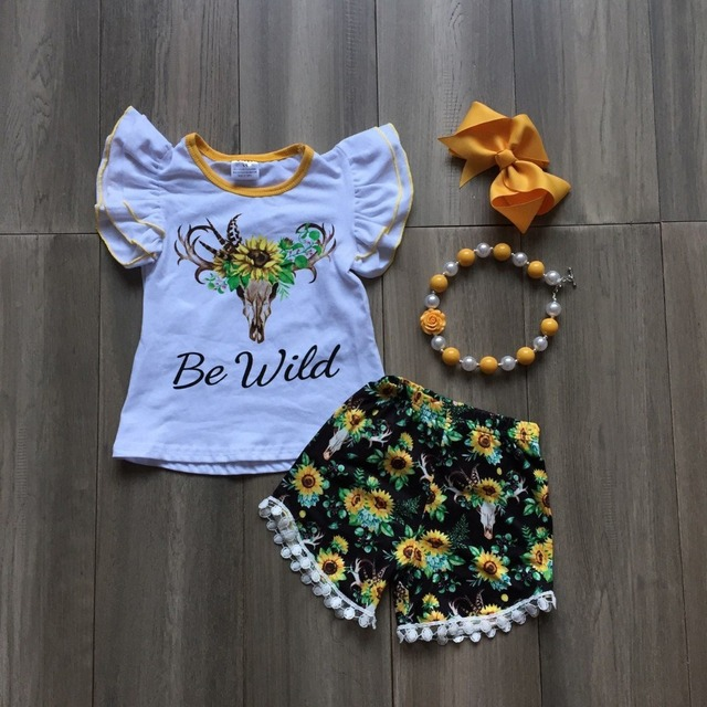 Mùa Hè mới bé gái màu đen vàng pom-pom quần short được hoang dã hướng dương mô hình bò trẻ em quần áo boutique phù hợp với phụ kiện