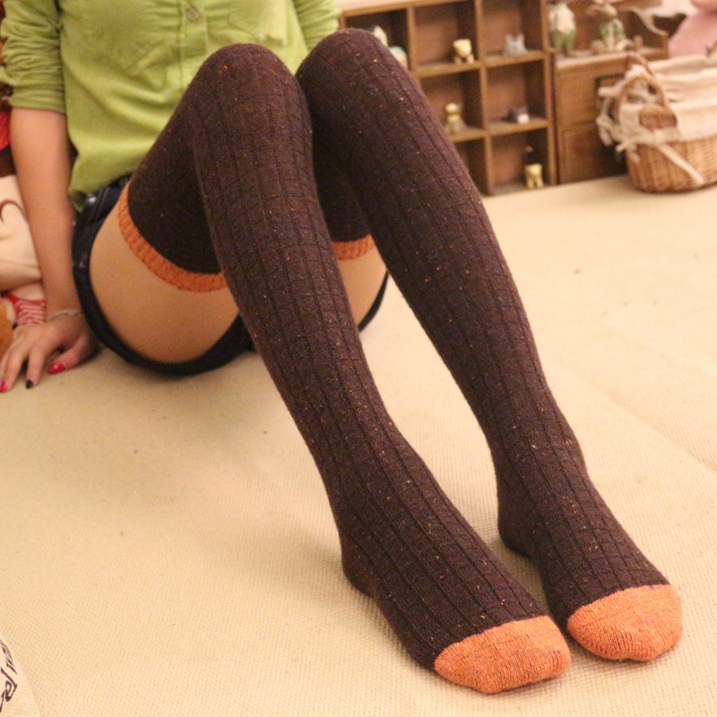 Thigh high, heavyweight Merino wool stockings, One Size fits most. Available in 7 solid colors. These socks are thick, durable, very long, and your best friend on a cold winter day.